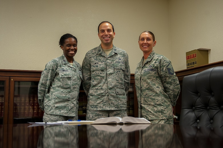 U.S. Air Force Capt. Yolanda Miller (left), Capt. Joseph Wise (center), area defense counselors, and Master Sgt. Stephanie Clark (right), Area Defense Counsel paralegal, make up the ADC team. The ADC is comprised of two attorneys and a paralegal who provide legal counsel to Airmen. (U.S. Air Force photo by Airman 1st Class Corey M. Pettis)