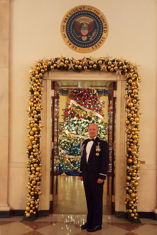 Air Force Capt. John D. Fesler stands in front of doorway to the Blue Room in Cross Hall of the White House. Fesler is the first Airman from the Air National Guard to serve as a White House social aide. (Photo courtesy of National Guard Bureau)