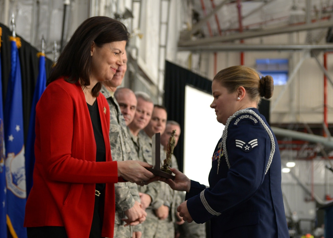 United States Senator Kelly Ayotte congratulates Senior Airman Sarah Laperle for winning the Honor Guard Member of the Year Award during the 157th Air Refueling Wing Commander's Call at Pease Air National Guard Base, N.H., Dec. 6, as senior leaders look on. Also named as award winners during the annual event were: Airman of the Year: Senior Airman Christopher S. Storm; NCO of the Year: Tech. Sgt. Amanda M. Bogue; Senior NCO of the Year: Master Sgt. Jay Gorsline; First Sergeant of the Year: Master Sgt. Jessica L. McWain; Company Grade Officer of the Year: Capt. Joseph A. Smith III; Spirit of Hope Award: Tech. Sgt. Kayla M. Carpenter; Honorary Recruiter of the Year Award: Airman 1st Class Jesse Bornkessel. (U.S. National Guard photo by Airman 1st Class Ashlyn Correia)