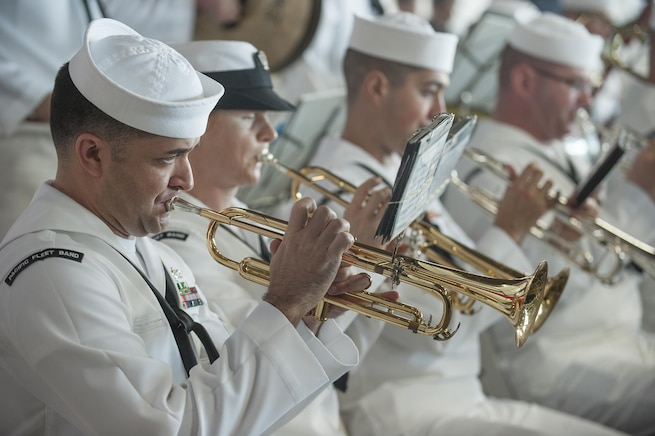 Navy Petty Officer 1st Class Brandon Barbie, left, performs with other band members during the 74th anniversary observance of the Dec. 7, 1941, Pearl Harbor attacks at Joint Base Pearl Harbor-Hickam, Hawaii, Dec. 7, 2015. Barbie is a trumpet musician assigned to U.S. Pacific Fleet Band. U.S. Air Force photo by Staff Sgt. Christopher Hubenthal