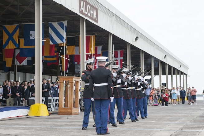 A Marine Corps honor guard detail performs a rifle salute during the Pearl Harbor Day Commemoration Anniversary at Joint Base Pearl Harbor-Hickam, Hawaii, Dec. 7, 2015. U.S. Air Force photo by Staff Sgt. Christopher Hubenthal