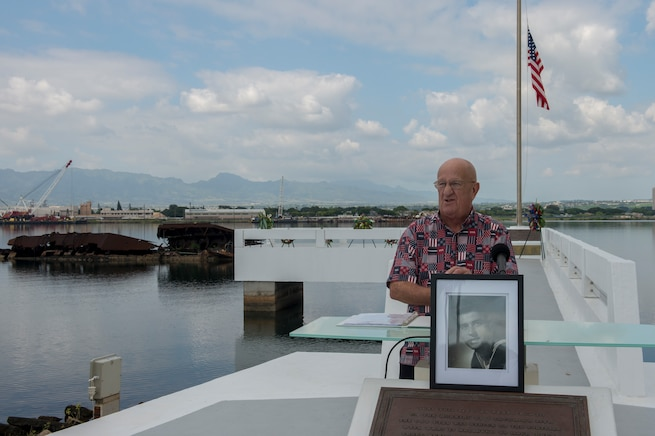 Retired Navy Master Chief Yeoman Jim Taylor, Pearl Harbor survivor liaison, initiates an ash-scattering ceremony in honor of retired Navy Chief boatswain's mate Donald Show, a USS Phoenix survivor, at the USS Utah Memorial during the Pearl Harbor Day commemoration anniversary at Joint Base Pearl Harbor-Hickam, Hawaii, Dec. 7, 2015. U.S. Navy photo by Petty Officer 3rd Class Katarzyna Kobiljak