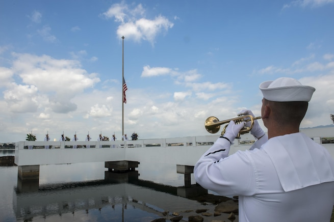 Navy Petty Officer 2nd Class Rick Baty plays taps on a bugle during an ash-scattering ceremony in honor of retired Navy Chief boatswain's mate Donald Show, a USS Phoenix survivor, at the USS Utah Memorial during the Pearl Harbor Day commemoration anniversary at Joint Base Pearl Harbor-Hickam, Hawaii, Dec. 7, 2015. Baty is a musician assigned to U.S. Pacific Fleet Band. U.S. Navy photo by Petty Officer 3rd Class Katarzyna Kobiljak