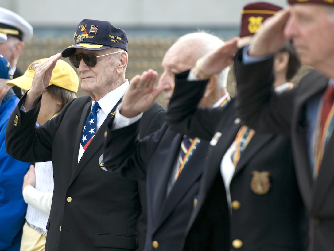 Veterans render a salute after laying wreaths during a Pearl Harbor remembrance ceremony at the National World War II Memorial on Dec. 7, 2015, in Washington, D.C. (U.S. Air Force photo/Sean Kimmons)