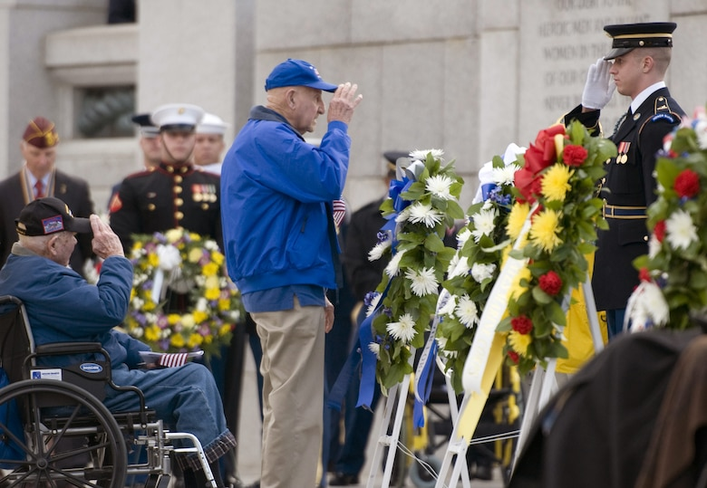 Two World War II veterans render a salute after laying a wreath during a Pearl Harbor remembrance ceremony at the National WWII Memorial on Dec. 7, 2015, in Washington, D.C. (U.S. Air Force photo/Sean Kimmons)