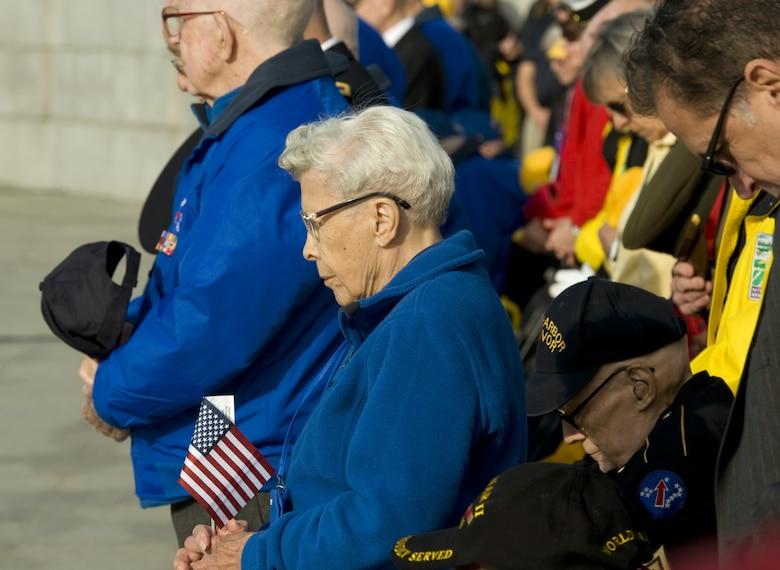 Esther Spring, who served in the Army Nurse Corps, and other World War II veterans bow their heads at the start of a Pearl Harbor remembrance ceremony at the National WWII Memorial on Dec. 7, 2015, in Washington, D.C. (U.S. Air Force photo/Sean Kimmons)