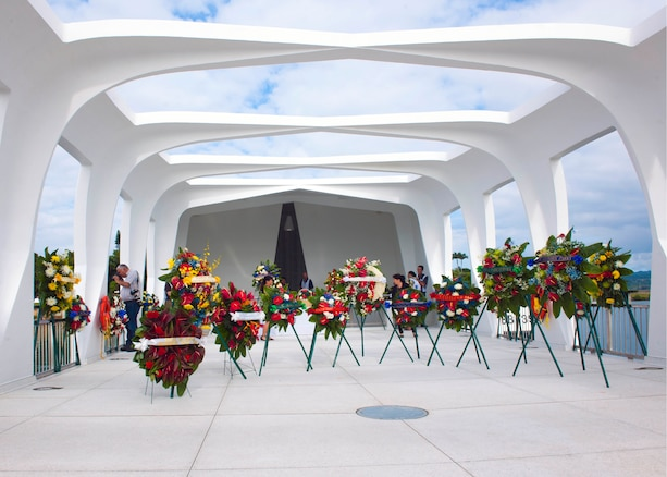 Wreaths adorn the USS Arizona Memorial on Joint Base Pearl Harbor-Hickam, Hawaii, Dec. 7, 2015, where a remembrance ceremony was held to honor survivors and those who lost their lives in the attacks on Pearl Harbor 74 years ago. U.S. Navy photo by Petty Officer 2nd Class Jeff Troutman