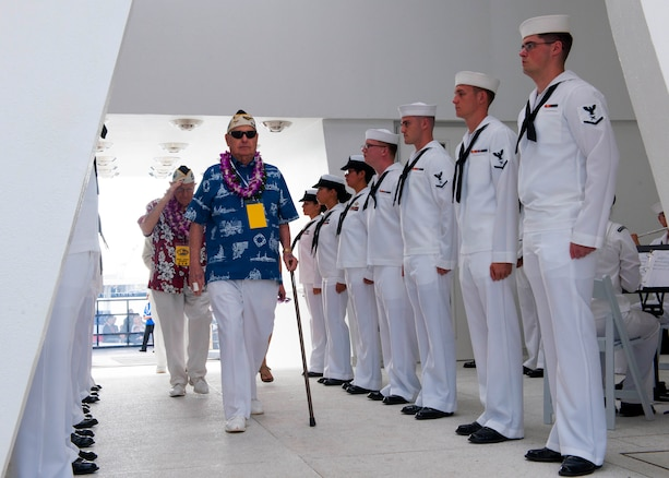 Survivors of the attacks on Pearl Harbor enter the USS Arizona Memorial for a wreath dedication ceremony to mark the 74th anniversary of the attacks, on Joint Base Pearl Harbor-Hickam, Hawaii, Dec. 7, 2015. U.S. Navy photo by Petty Officer 2nd Class Jeff Troutman