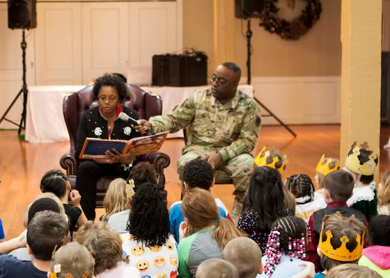 """Children listen as Cynthia Dix, wife of DLA Distribution commander Army Brig. Gen. Richard Dix, reads the """"The Night Before Christmas."""""""