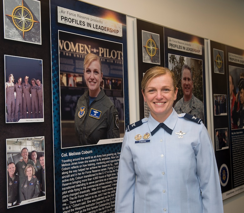 Air Force Reserve Col. Melissa Coburn stands next to her during at the unveiling the Profiles in Leadership display in the Pentagon, Washington D.C., Dec. 7, 2015. The display highlights outstanding examples of leadership in the Air Reserve forces, and celebrates and honors Citizen Airmen's contributions in serving the nation. (U.S. Air Force Photo/Jim Varhegyi)