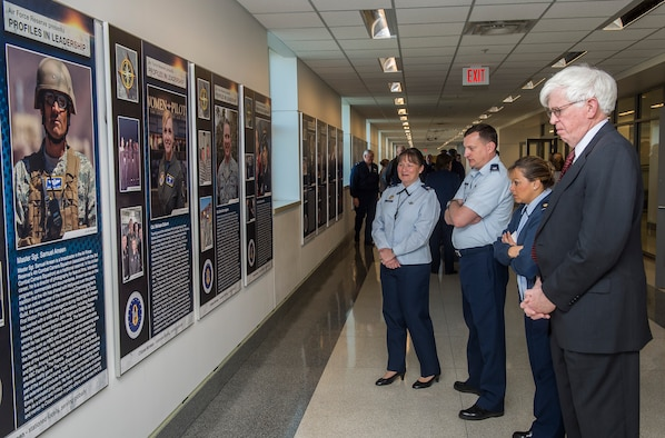 Members of the Air Force Reserve community look over the panels after the unveiling of the Profiles in Leadership display in the Pentagon, Washington D.C., Dec. 7, 2015. The display highlights outstanding examples of leadership in the Air Reserve forces, and celebrates and honors Citizen Airmen's contributions in serving the nation. (U.S. Air Force Photo/Jim Varhegyi)