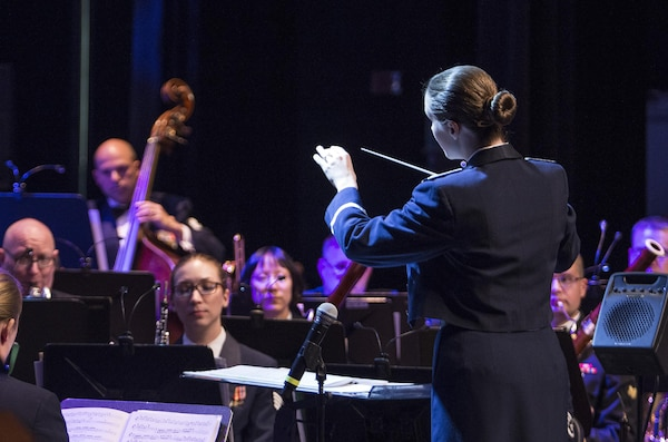 Second Lieutenant Christina A. Muncey, United States Air Force Band of the West flight commander and associate conductor, conducts members of the USAF Band of the West during the Holiday in Blue concert Dec. 7, 2015 at the Edgewood Independent School District Theatre for the Performing Arts in San Antonio, Texas. The concert included a variety of holiday songs from around the world, a children's story and a sing-a-long. Attendees included members of JBSA, community members and retirees. The Airmen assigned to the band are highly-trained professional musicians who have dedicated themselves to serving their country through music. (U.S. Air Force photo by Johnny Saldivar)