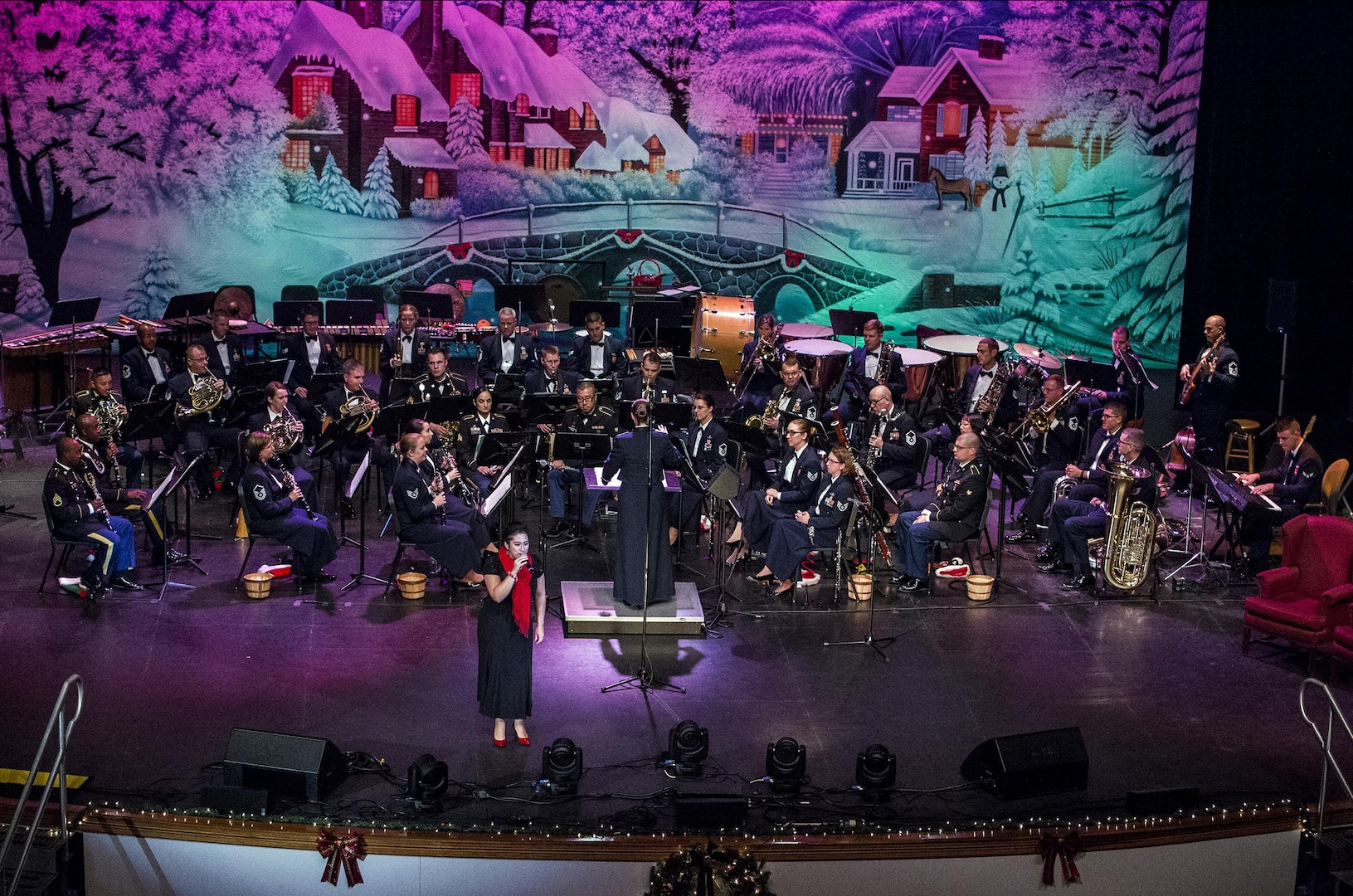 Airman 1st Class Alycia Cancel, United States Air Force Band of the West vocalist, performs during the Holiday in Blue concert Dec. 7, 2015 at the Edgewood Independent School District Theatre for the Performing Arts in San Antonio, Texas. The concert included a variety of holiday songs from around the world, a children's story and a sing-a-long. Attendees included members of JBSA, community members and retirees. The Airmen assigned to the band are highly-trained professional musicians who have dedicated themselves to serving their country through music. (U.S. Air Force photo by Johnny Saldivar)