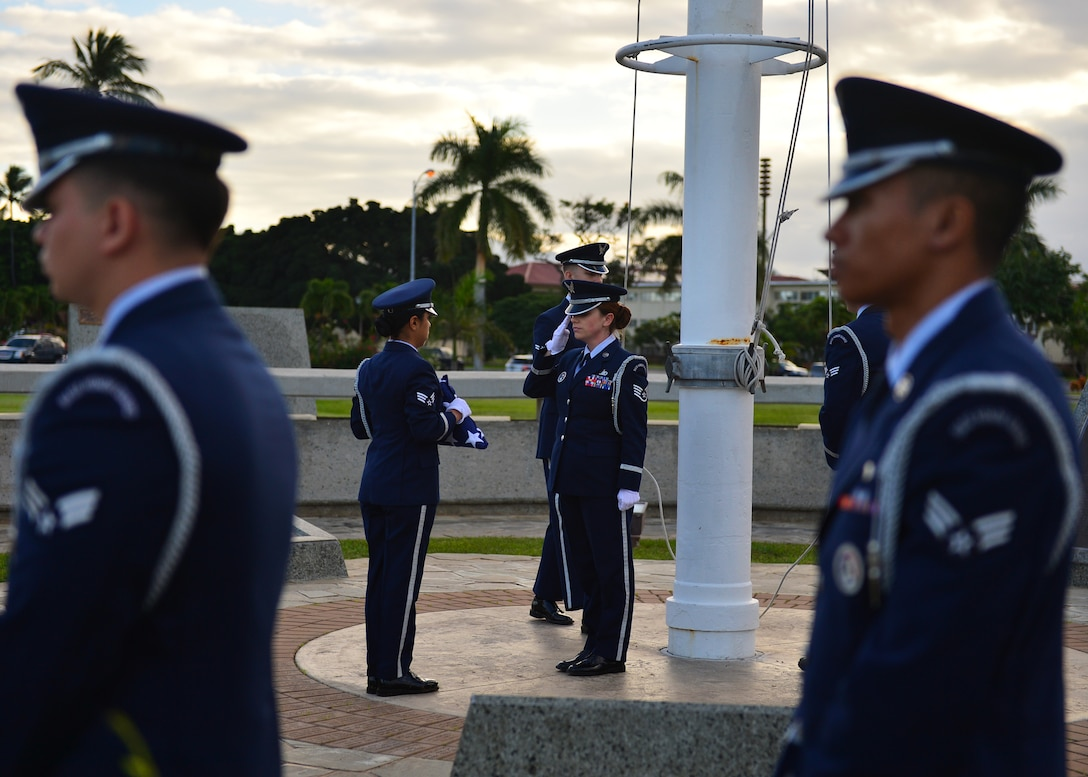 Members of the Hickam Honor Guard perform flag detail during the 74th attack on Hickam Field Remembrance Ceremony hosted by the 15th Wing on Joint Base Pearl Harbor-Hickam, Hawaii, Dec. 7, 2015. Survivors and their family members attended the ceremony, which honors the men and women who lost their lives on Hickam Field during the two waves of attacks launched by the Imperial Japanese Navy on Dec. 7, 1941. (U.S. Air Force photo by Tech. Sgt. Aaron Oelrich/Released)