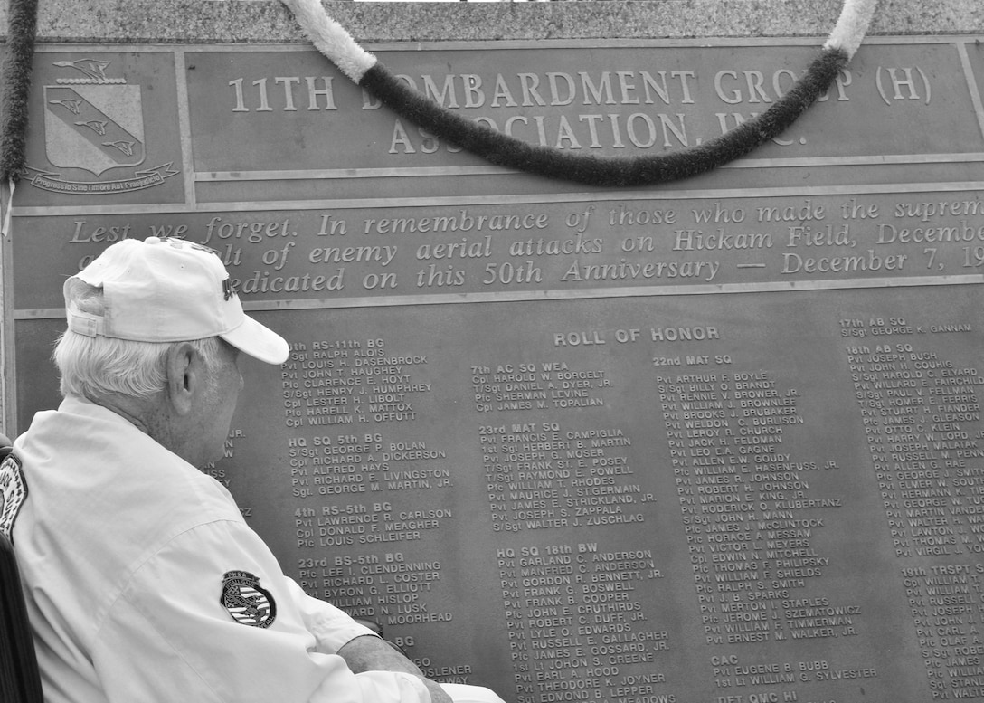 Durward Swanson looks for his former commander on the 7 December Memorial Plaque after participating in the 74th Remembrance Ceremony hosted by the 15th Wing on Joint Base Pearl Harbor-Hickam, Hawaii, Dec. 7, 2015. Survivors and their family members attended the ceremony, which honors the men and women who lost their lives on Hickam Field during the two waves of attacks launched by the Imperial Japanese Navy on Dec. 7, 1941. (U.S. Air Force photo by Tech. Sgt. Aaron Oelrich/Released)