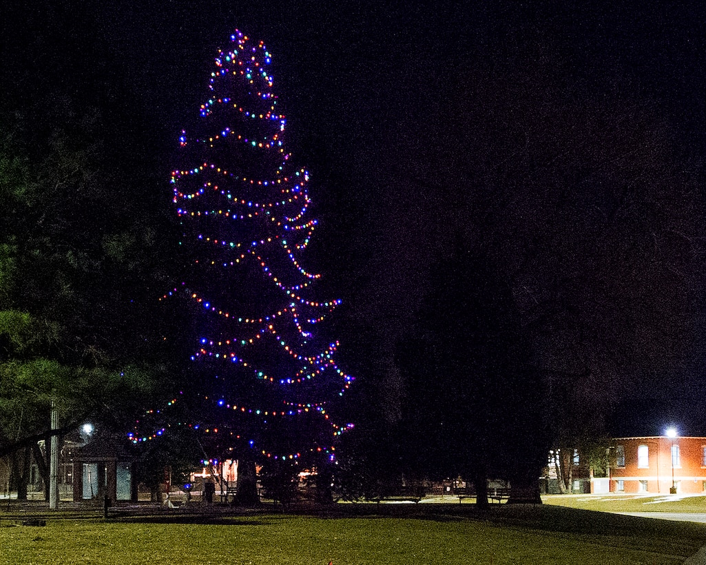 The F.E. Warren Air Force Base, Wyo., holiday tree glows with multicolored lights Dec. 4, 2015, following the annual tree lighting festivities. (U.S. Air Force photo by R.J. Oriez)