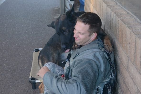 Rango, 56th Security Forces Squadron military working dog, licks Staff Sgt. Justin Gonzalez, 56th Security Forces Squadron MWD handler, at Luke Air Force Base, Arizona, Nov. 17, 2015. It's important for MWD handlers to develop a good working relationship with their dogs to strengthen the bond between them, Gonzalez said. (U.S. Air Force photo by Senior Airman James Hensley)