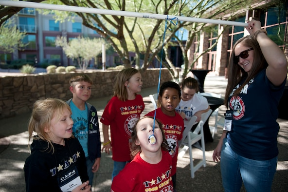 Senior Airman Christina Varland, 56th Component Maintenance Squadron administration specialist, participates as a mentor for the Transition Assistance Program for Survivors camp in Scottsdale, Arizona Dec. 5, 2015. TAPS is different from other grief programs in that the directors make a point to match the children with active-duty mentors. (U.S. Air Force photo by Staff Sgt. Staci Miller)