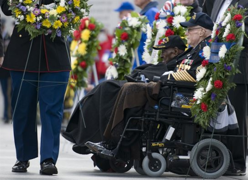 Edward Davis, right, a 94-year-old Army veteran who witnessed the Japanese sneak attack on Hawaii, and Frank Levingston, a 110-year-old Army veteran believed to be the nation's oldest living World War II veteran, attend a Pearl Harbor remembrance ceremony at the National World War II Memorial on Dec. 7, 2015, in Washington, D.C. (U.S. Air Force photo/Sean Kimmons)