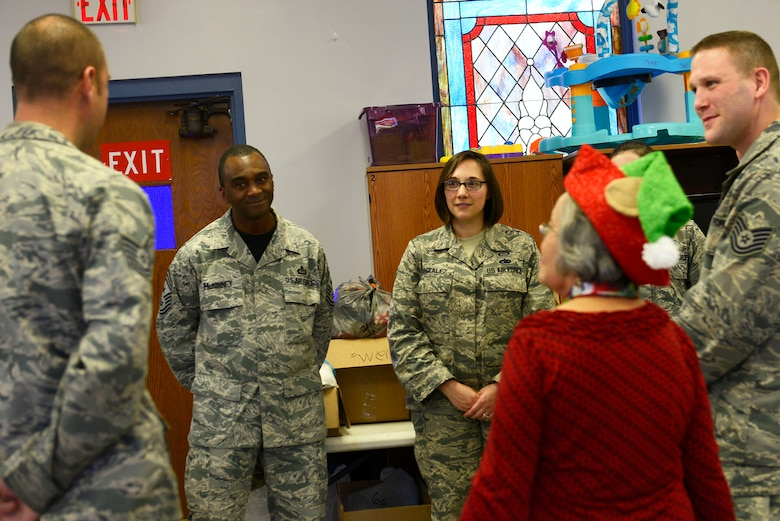 U.S. Air Force Chief Master Sgt. Christopher McKinney, 20th Fighter Wing command chief, converses with volunteers at the Palmetto Chapel at Shaw Air Force Base, S.C., Dec. 4, 2015. McKinney made a visit to the Palmetto Chapel to show his support for Operation True Giving and what it provides for the Shaw and Sumter community. (U.S. Air Force photo by Airman 1st Class Christopher Maldonado)