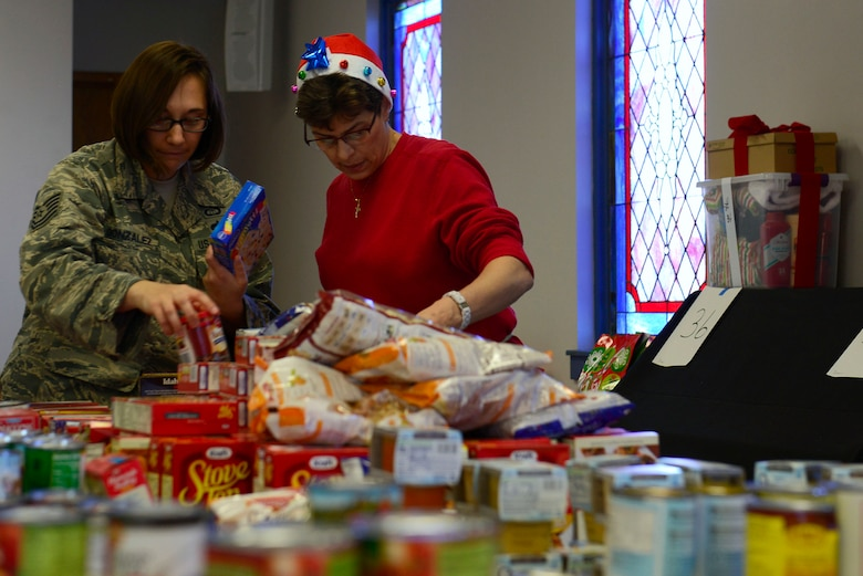 Volunteers organize non-perishable goods at the Palmetto Chapel in support of Operation True Giving at Shaw Air Force Base, S.C., Dec. 4, 2015. Operation True Giving will help 83 families have a bright Christmas by providing  food, clothing, and many great gifts. (U.S. Air Force photo by Airman 1st Class Christopher Maldonado)