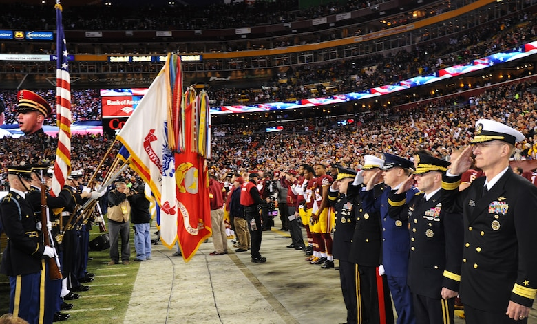 Air Force District of Washington Commander Maj. Gen. Darryl Burke joins his counterparts from Joint Force Headquarters-National Capital Region to honor the nation's colors during pre-game activities for the Washington Redskins versus Dallas Cowboys game, Dec. 7, 2015 at FedEx Field in Landover, Md. The Washington Redskins continued their tradition of honoring the nation's veterans and active duty military through the team's annual Salute to Service game. (U.S. Air Force photo by James E. Lotz/RELEASED).
