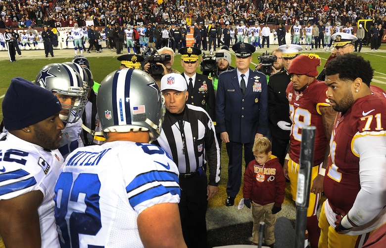 Air Force District of Washington Commander Maj. Gen. Darryl Burke observes the coin toss for the Washington Redskins versus Dallas Cowboys game, Dec. 7, 2015 at FedEx Field in Landover, Md. The Washington Redskins continued their tradition of honoring the nation's veterans and active duty military through the team's annual Salute to Service game. (U.S. Air Force photo by James E. Lotz/RELEASED).