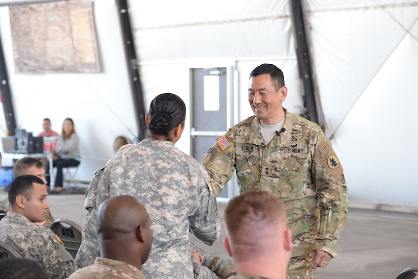 U.S. Army Maj. Gen. K.K. Chinn, Army South commander, gives a coin to a Soldier stationed at Soto Cano Air Base, Honduras, Dec. 8, 2015. Chinn came to Soto Cano to give the Soldiers a better idea of how their work is helping to build relationships between partner nations throughout the Central American area of responsibility. (U.S. Air Force photo by Senior Airman Westin Warburton/Released)