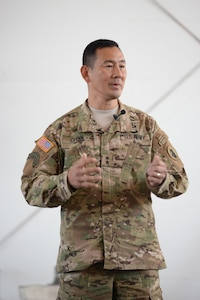 U.S. Army Maj. Gen. K.K. Chinn, Army South commander, speaks to a group of Soldiers stationed at Soto Cano Air Base, Honduras, Dec. 8, 2015 during a town hall style discussion. Chinn came to Soto Cano to give the Soldiers a better idea of how their work is helping to build relationships between partner nations throughout the Central American area of responsibility. (U.S. Air Force photo by Senior Airman Westin Warburton/Released)
