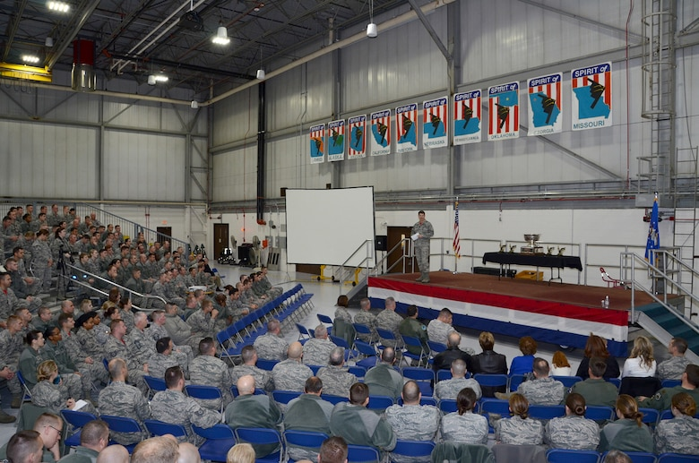 """The 131st Bomb Wing commander, Col. Mike Francis, addresses assembled Citizen Airmen at Whiteman Air Force Base, Missouri, during the end-of-year commander's call to review significant events and recognize Outstanding Airmen of the Year winners, December 6. 2015. Noting that all commanders tell their units they're busy, Francis emphasized how true that statement is for the 131st, adding, """"They're not doing it in the B-2.  They're not doing it in the nuclear enterprise.""""   (U.S. Air National Guard photo by Staff Sgt. Brittany Cannon)"""
