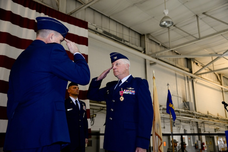 A picture of Col. Michael Love receiving The Legion of Merit.