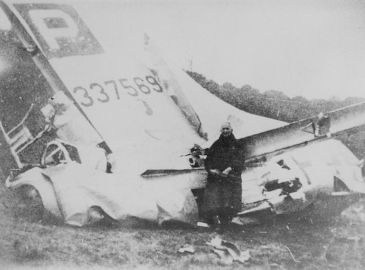 An unknown man poses in front of a downed B-17 Flying Fortress, tail number 4337569, following a dogfight which occurred, Dec. 24, 1944. The aircraft's crew included 1st Lt. Vernal Cuno Becker, the tail gunner on the mission, and great-uncle of current U.S. Air Force Chief Master Sgt. James McCloskey. (Courtesy photo)