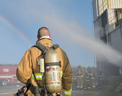 Tech. Sgt. Brian Devlin, 109th Fire Department station captain, looks on during a live fire exercise in Ballston Spa, New York, on Dec. 5, 2015. (U.S. Air National Guard photo by Staff Sgt. Ben German/Released)