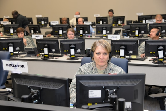 Col. Constance Jenkins, Air Mobility Command Reserve Advisor to the Director of Logistics, Engineering and Force Protection, works in the AMC and 18th Air Force Crisis Battle Staff as Director during Exercise Global Thunder/Vigilant Shield at 18th AF headquarters on Scott Air Force Base, Nov. 5, 2015. The Crisis Battle Staff is a collection of experts drawn from across AMC and 18th AF that activates on a round-the-clock basis to address a specific crisis. The CBS team is supposed to be fully functional within an hour of being recalled to support the 18th AF commander during crises ranging from natural disasters to nuclear war. (U.S. Air Force photo by Master Sgt. Thomas J. Doscher)