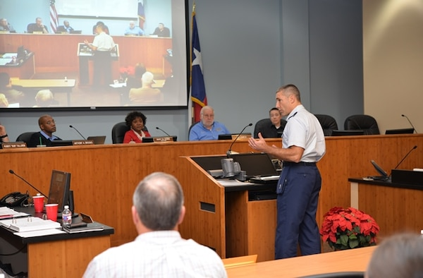Col. Matt Isler, 12th Flying Training Wing commander, addresses the Live Oak City Council to answer questions about the Joint Land Use Study during its meeting Dec. 8, 2015.  The council voted 5-0 to adopt the study, ensuring joint development planning and compatible land use between the city and Joint Base San Antonio-Randolph.
