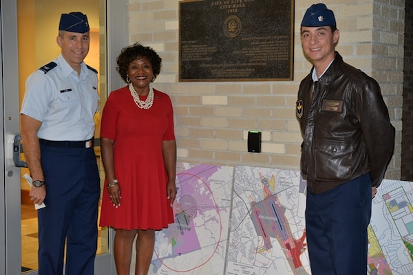 Col. Matt Isler (left), 12th Flying Training Wing commander, Live Oak Mayor Mary Dennis and Lt. Col. Robin Baldwin, 12 FTW Community Initiatives Officer, after the Live Oak City Council meeting Dec. 8, 2015.  The council voted 5-0 to adopt the Joint Land Use Study, ensuring joint development planning and compatible land use between the city and Joint Base San Antonio-Randolph.