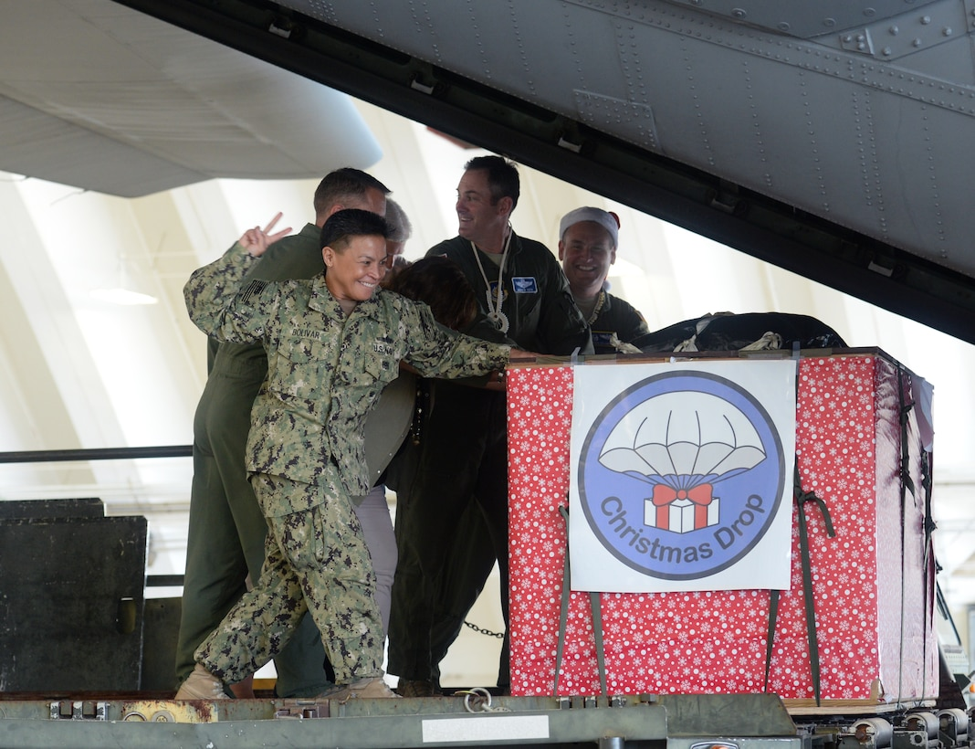 Rear Adm. Babette Bolivar, the Joint Region Marianas commander, counts down before pushing a crate containing donated goods into a C-130 Hercules during the Christmas Drop Push Ceremony Dec. 8, 2015, at Andersen Air Force Base, Guam. Operation Christmas Drop, which has been conducted for 64 years, recieved support from the Japan Air Self-Defense Force and the Royal Australian Air Force for the first time. (U.S. Air Force photo/Staff Sgt. Benjamin Gonsier)
