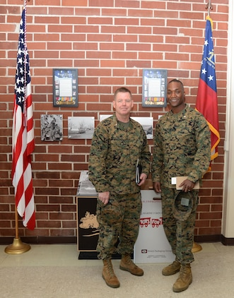 Base officials welcome Marine Corps Installations East's command chaplain, Capt. Thomas Stewart (left), U.S. Navy, based out of Camp Lejeune, N.C., for his first visit to Marine Corps Logistics Base Albany, Dec. 8. According to Lt. Col. Nathaniel Robinson (right), executive officer, MCLB Albany, Stewart's visit was an orientation to the base, the leadership team, the Chapel of the Good Shepherd and some of the installation's other amenities.
