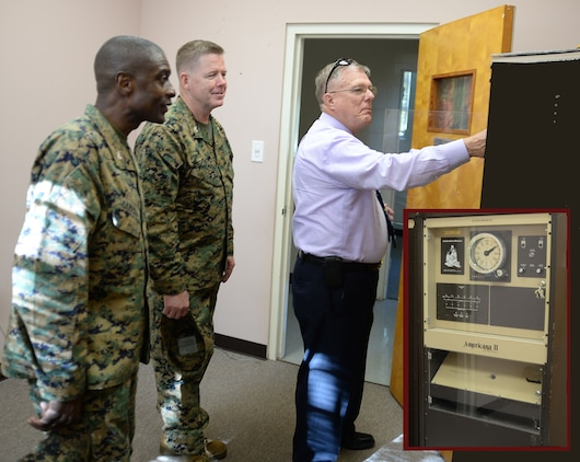 Bob James (right), director, Operations and Training Division, Marine Corps Logistics Base Albany, demonstrates the operations of the chimes system (inset) at the Chapel of the Good Shepherd, here, Dec. 8. Col. James C. Carroll III (left), commanding officer, MCLB Albany, and base leadership welcomed Marine Corps Installations East's command chaplain, Capt. Thomas Stewart (center), U.S. Navy, based out of Camp Lejeune, N.C., for his first visit to the installation.