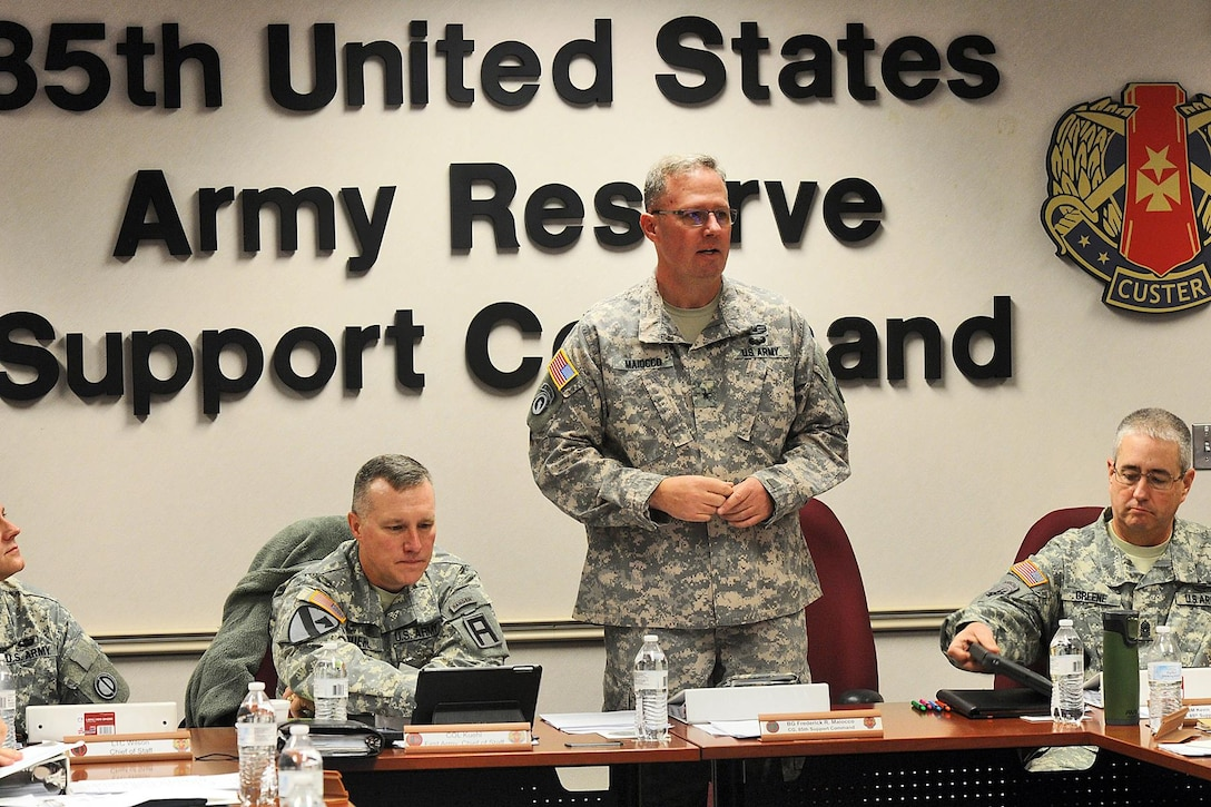 Army Reserve Brig. Gen. Frederick R. Maiocco, Jr., commanding general, 85th Support Command, gives opening remarks during the First Army brigade executive officers brief on Dec. 4. The purpose of the briefing was to assist the active component brigades better understand the different processes within their Army Reserve battalions, and improve communications between the active and reserve units assigned to the brigades. (U.S. Army photo by Spc. David Lietz/Released)