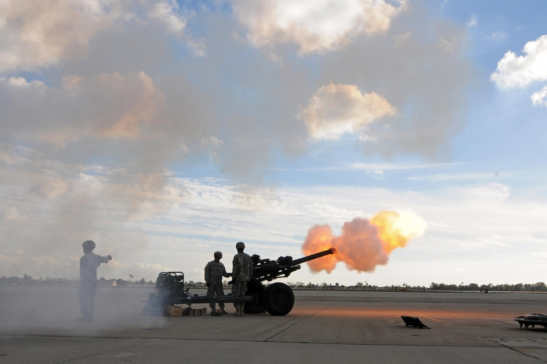 Members of Bravo Battery, 1-143rd Field Artillery, conduct a 21-gun salute during a ceremony where Maj. Gen. Mark Palzer took command of the 79th Sustainment Support Command from Maj. Gen. Megan P. Tatu at Joint Forces Training Base Los Alamitos, Calif., Dec. 5, 2015. (U.S. Army photo by Spc. Heather Doppke/released)