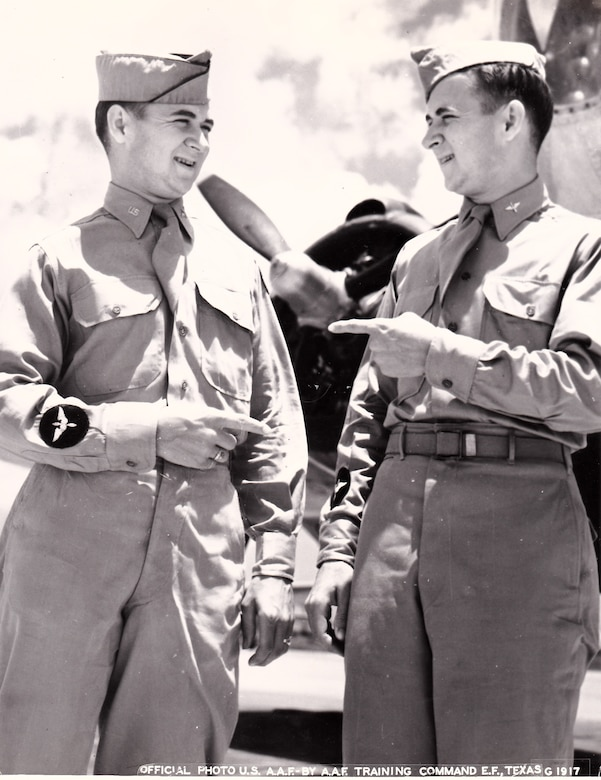 "A vintage photo of retired Air Force Reserve Majs. Raymond ""Glenn"" Clanin and Russell ""Lynn"" Clanin during training in the Aviation Cadet program, prior to receiving their pilot wings in August 1944 at Ellington Field, Texas. Seventy-one years later, the 92-year-old twin brothers are recipients of the French government's highest distinction for their military service as World War II veterans, the Legion of Honor medal. (Courtesy photo/U.S. Army Air Forces, AAF Training Command)"