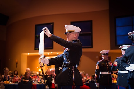 Capt. Terry Herzog, 12th Marine Corps District Adjutant, reads MajGen. John A. Lejuene's Birthday Message, at the 12th MCD ball ceremony in San Diego, Ca. Nov. 6, 2015. The Birthday Message is read at every Marine Corps Ball and established that a reminder of the honorable service of the Corps be published by every command, to all Marines throughout the globe, on the Birthday of the Corps. (Photo provided by SSgt. Joseph Ford)