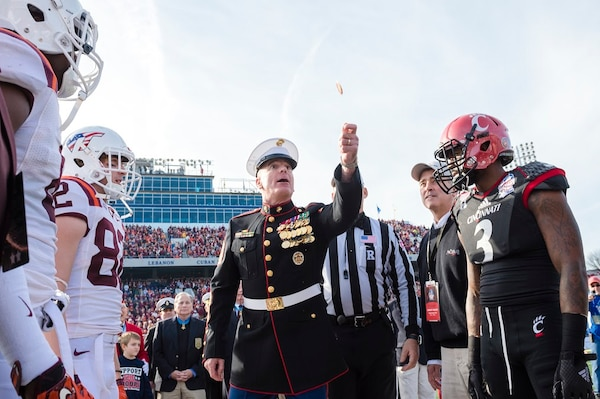 Marine Corps Sgt. Maj. Bryan B. Battaglia, the senior enlisted advisor to the chairman of the Joint Chiefs of Staff, attends the 2014 Military Bowl at Navy-Marine Corps Memorial Stadium in Annapolis, Md., Dec. 27, 2014. Battaglia served as Grand Marshall of the Military Bowl Parade; spoke during a Medal of Honor and USO reception; and conducted the game's coin toss. Virginia Tech defeated Cincinnati 33-17. DoD photo by Army Staff Sgt. Sean K. Harp