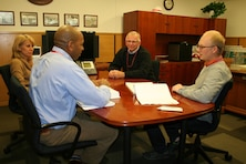 Omaha District architects, Karen Jarvis, Askelon Parker (left) and Andy Temeyer (right) sat down with Northwestern Division Military Construction program manager Dave Packard to talk about design projects at Fort Carson, Colorado.