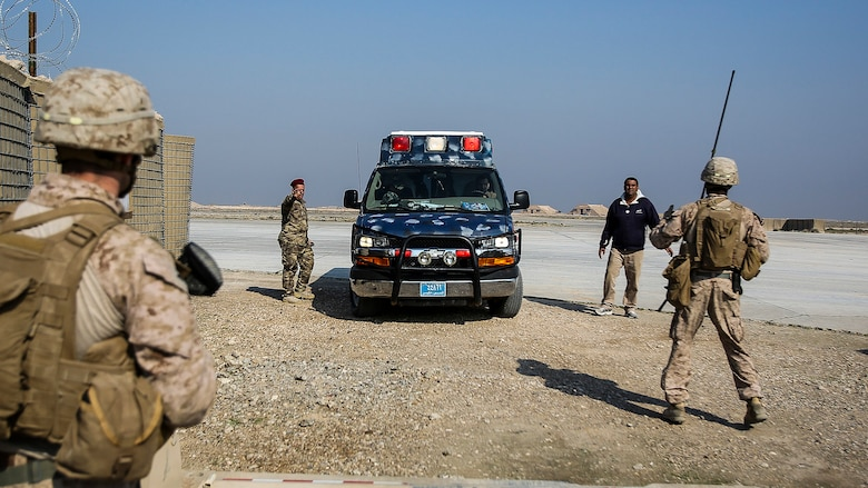 """U.S. Marines with Company B, 1st Battalion, 7th Marine Regiment, Special Purpose Marine Air Ground Task Force – Crisis Response – Central Command, prepare to search an ambulance carrying an injured Iraqi soldier at Al Taqaddum, Iraq, Nov. 28, 2015. Wounded Iraqi soldiers are occasionally transported from battlefields in Ramadi and Fallujah, Iraq, to Al Taqaddum to receive medical treatment from U.S. personnel. U.S. Navy corpsmen with """"Bravo"""" Company, 1st Bn., 7th Marines, are the first responders to attend to the casualties. U.S. Marines and sailors with SPMAGTF-CR-CC are currently deployed in support of Combined Joint Task Force - Operation Inherent Resolve, which focuses on enabling Iraqi forces to counter ISIL, reestablish Iraq's borders and retake lost terrain thereby restoring regional stability and security."""