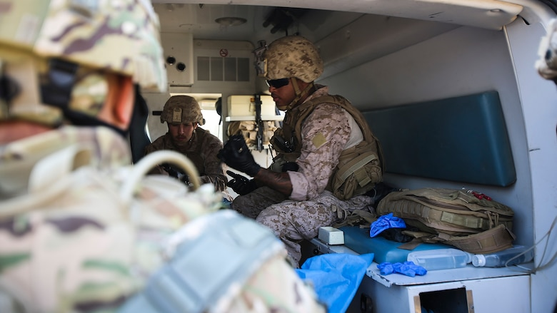 U.S. Navy corpsmen with Company B, 1st Battalion, 7th Marine Regiment, Special Purpose Marine Air Ground Task Force – Crisis Response – Central Command, treat an Iraqi soldier for combat-related injuries at Al Taqaddum, Iraq, Nov. 28, 2015. Wounded Iraqi soldiers are occasionally transported from battlefields in Ramadi, Iraq, to Al Taqaddum to receive medical treatment from U.S. personnel. U.S. Marines and sailors with SPMAGTF-CR-CC are currently deployed in support of Combined Joint Task Force - Operation Inherent Resolve, which focuses on defeating the Islamic State of Iraq and Levant in the U.S. Central Command area of responsibility.