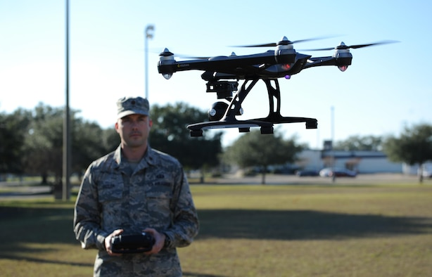 Maj. Joshua D. Pitler, 81st Operations Support Flight commander, operates an Unmanned Aerial System, more commonly known as a drone, Dec. 8, 2015, at Keesler Air Force Base, Miss.  Drones are prohibited from being operated on base. For more information and guidance on the operation of UAS visit, www.FAA.gov/UAS/model_aircraft/ (U.S. Air Force photo by Kemberly Groue)