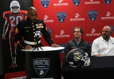 Sgt. Allen Leonard Jr., canvassing recruiter, Marine Corps Recruiting Station Columbia, speaks to those attending the Semper Fidelis All-American Bowl jersey presentation at Cuthbertson High School on Nov.3, 2015. Leonard presented Austin Kendall, quarterback, Cuthbertson High School, with his jersey to play in the bowl game in December.
