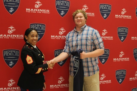 Gunnery Sgt. Wanda Evans, canvassing recruiter, Marine Corps Recruiting Station Columbia, speaks to those attending the Semper Fidelis All-American Bowl jersey presentation at Bamberg-Ehrhardt High School on Nov. 4. Evans presented Drew Wilson, senior, Bamberg-Ehrhardt High School, with his jersey in front of the entire student body.